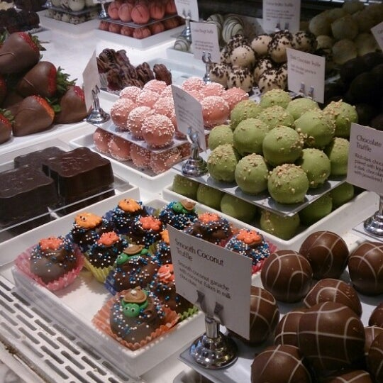 Photo taken at Godiva Chocolatier by Osama M. on 8/19/2013