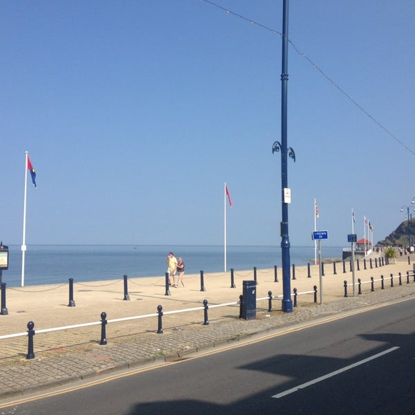 Photo taken at Aberystwyth Beach by Christian P. on 7/10/2013
