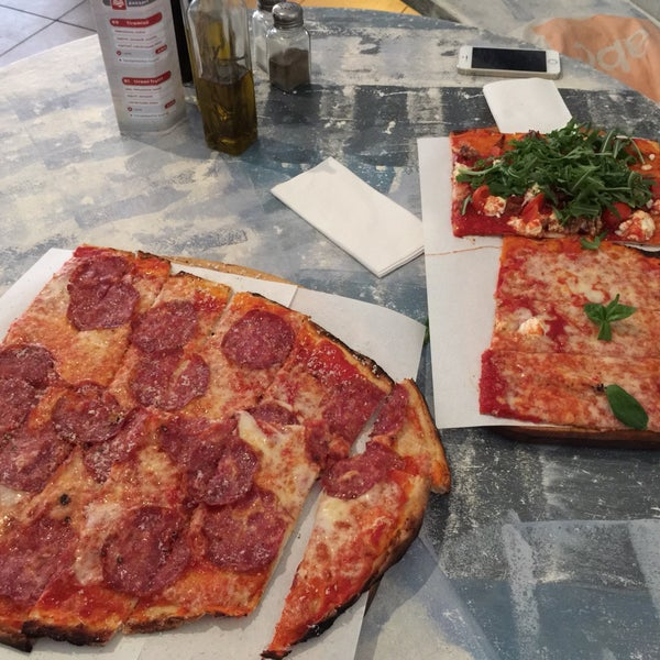 This is the best pizza in Berlin.  Thin, crusty and very authentic italian pizza. Fair prices, Friendly staff. The pizza on the left is 4 places and plenty!