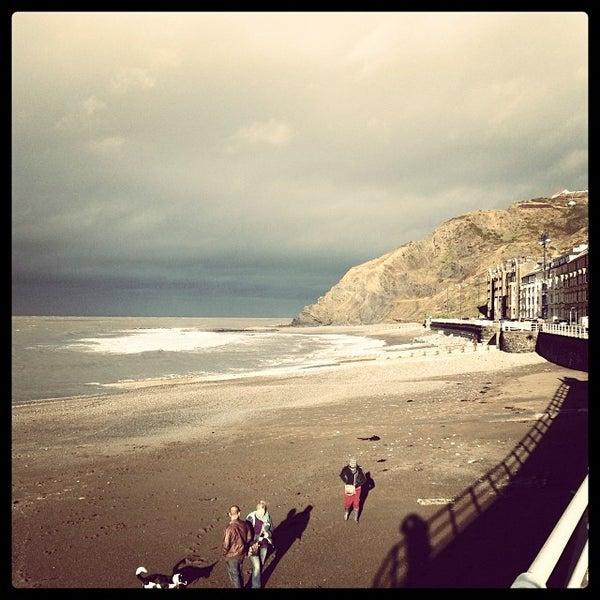 Photo taken at Aberystwyth Beach by Richie V. on 12/15/2013