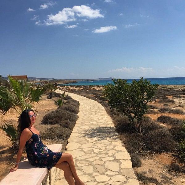 Photo taken at Makronissos beach by Alena G. on 9/24/2016