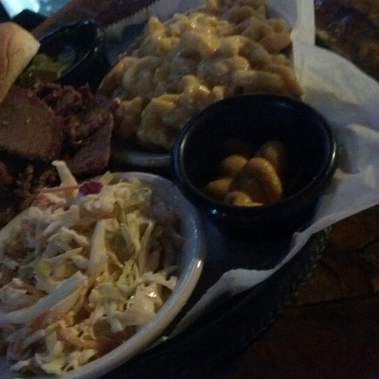 Photo taken at Momma's Mustard, Pickles, & BBQ by Kristopher C. on 2/12/2014