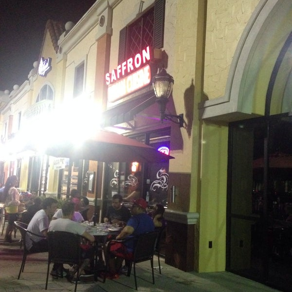 Photo taken at Saffron Indian Cuisine by Latifa A. on 8/17/2014
