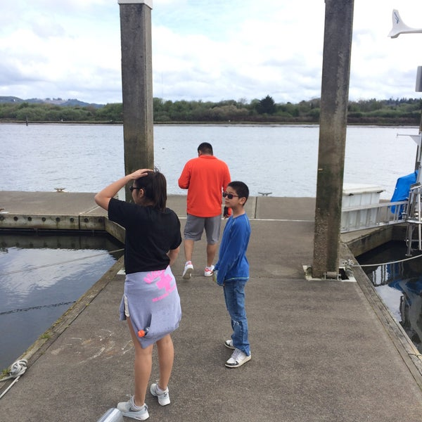 Photo taken at Coos Bay Boardwalk by Veronica M. on 3/24/2015