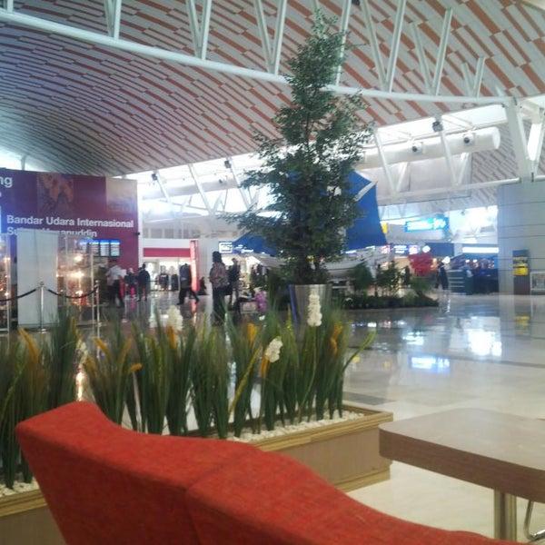 Photo taken at Sultan Hasanuddin International Airport (UPG) by Adrian M. on 7/16/2013
