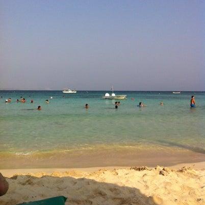 Photo taken at Makronissos Beach by Antonis M. on 7/28/2012