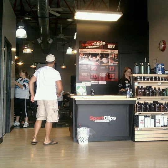 Photo taken at Sport Clips Haircuts of Mooresville by Marcus C. on 7/31/2011