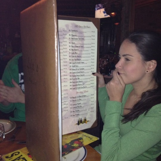 Photo taken at Lola Tapas & Wine Bar by Flavia V. on 2/20/2012