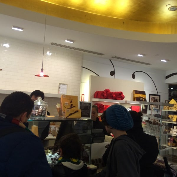 Photo taken at Godiva Chocolatier by Steven D. on 3/25/2014