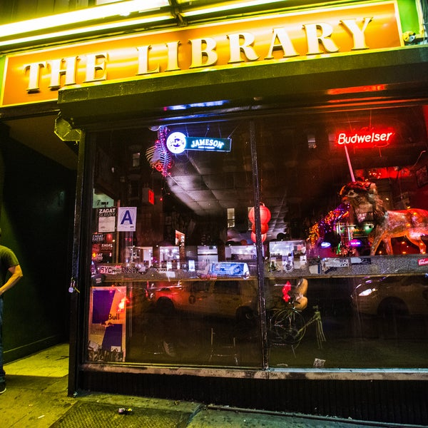 A projection screen and floor-to-ceiling bookshelves make this hip dive a respite from Houston Street chaos. The clientele drink PBR for just a few bucks, and locals wouldn't have it any other way.