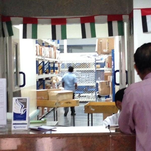 Photo taken at Emirates Post Office مكتب بريد الإمارات by Michelle N. on 12/30/2013