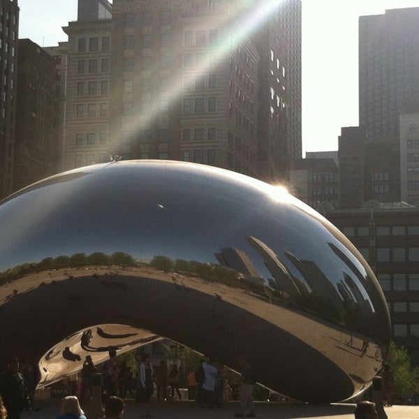 Photo taken at Cloud Gate by Anish Kapoor by Aly E. on 5/8/2013