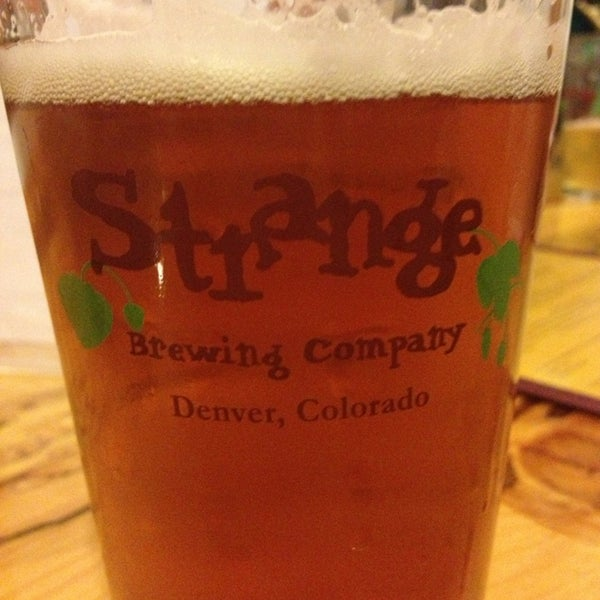 Photo taken at Strange Craft Beer Company by Melissa M. on 7/27/2013