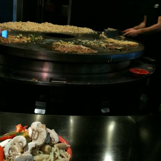 Photo taken at HuHot Mongolian Grill by Jen S. on 11/10/2012