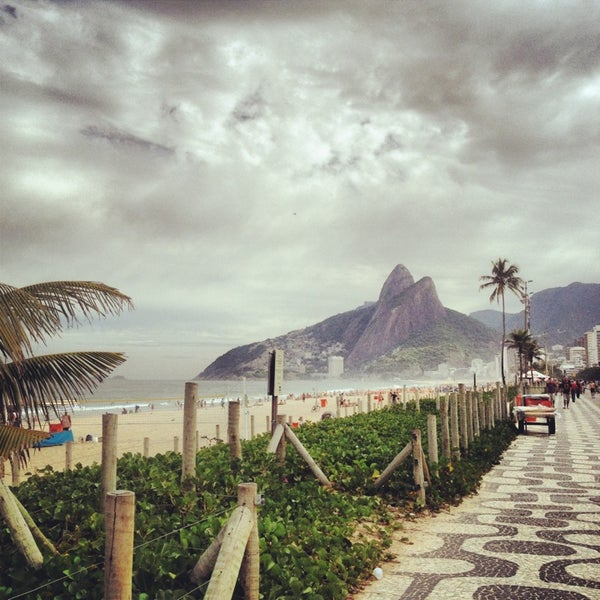 Photo taken at Ipanema Beach by Willa S. on 5/30/2013