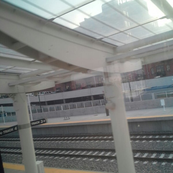 Photo taken at Denver Amtrak (DEN) by Coach B. on 12/1/2014