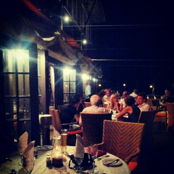 Photo taken at Champers Restaurant & Wine Bar by Omid A. on 2/6/2013