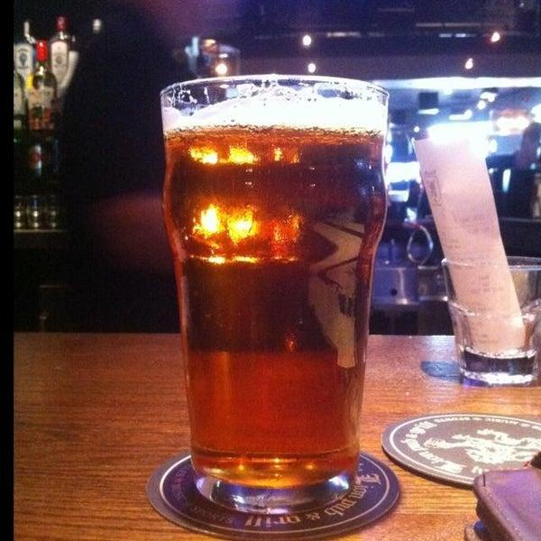Photo taken at Thirsty Lion Pub & Grill by Matt Q. on 6/8/2013