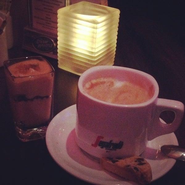 Photo taken at Glow Restaurant by Nana on 11/25/2013