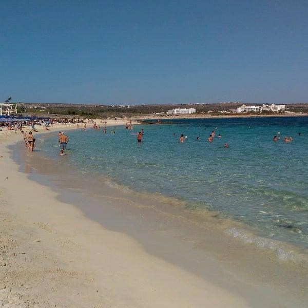 Photo taken at Makronissos Beach by Yuri E. on 10/1/2016
