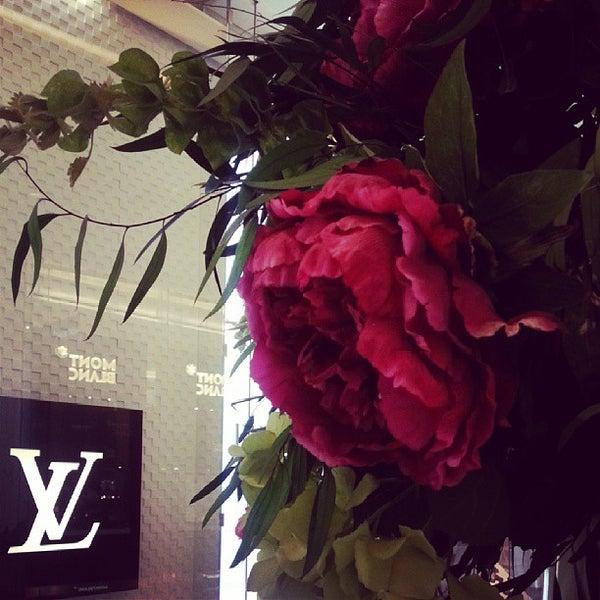 Photo taken at Louis Vuitton by DeeMaaH H. on 8/22/2013