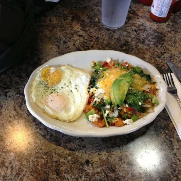 Photo taken at Eggs In the City by Tim K. on 3/20/2013