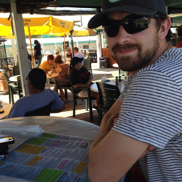 Photo taken at The Surf Restaurant & Bar by Whit H. on 4/13/2014