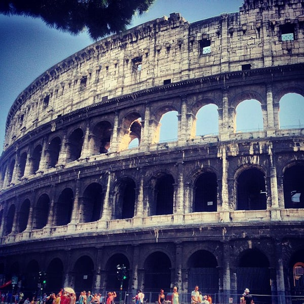 Photo taken at Piazza del Colosseo by Víctor M. on 7/27/2013