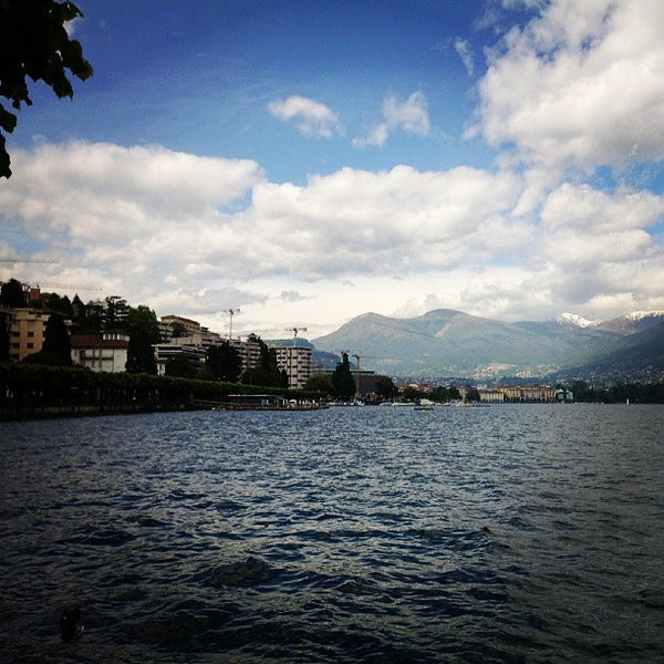 Photo taken at Lago di Lugano by Dasha U. on 6/1/2013