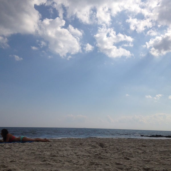 Photo taken at East Atlantic Beach by Shyla D. on 8/17/2014