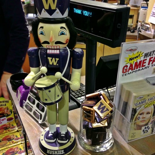 Photo taken at University Bookstore by Kate K. on 12/7/2012