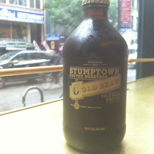 Photo taken at Stumptown Coffee Roasters by Jonathan V. on 10/19/2012