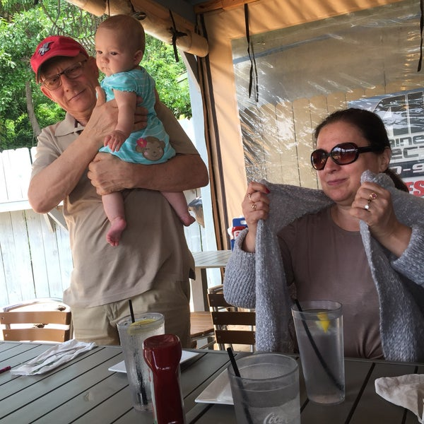 Photo taken at Fish Tales Lakeside Grille by Emily D. on 5/13/2017