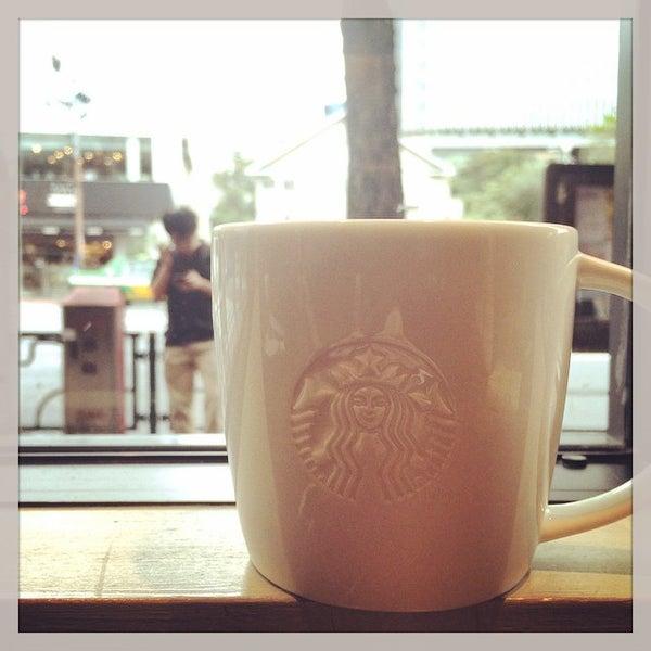 Photo taken at Starbucks by Tomohiro O. on 10/8/2014