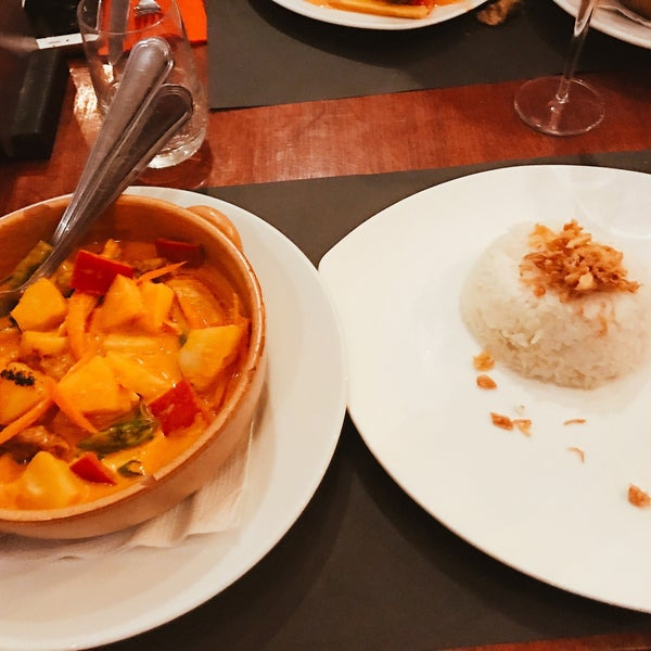 Belgian / Asian restaurant that serves delicious curries in large portions. Try the red curry with duck which was outstanding. Good service.