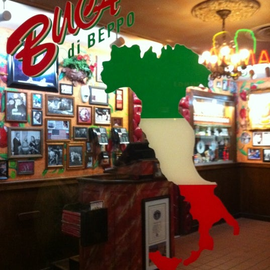 Photo taken at Buca di Beppo by Chris E. on 10/22/2012