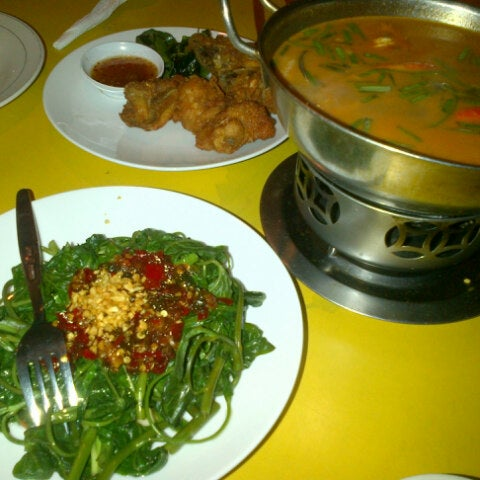 Photo taken at Phuket Thai Resto by Kartika p. on 11/26/2013