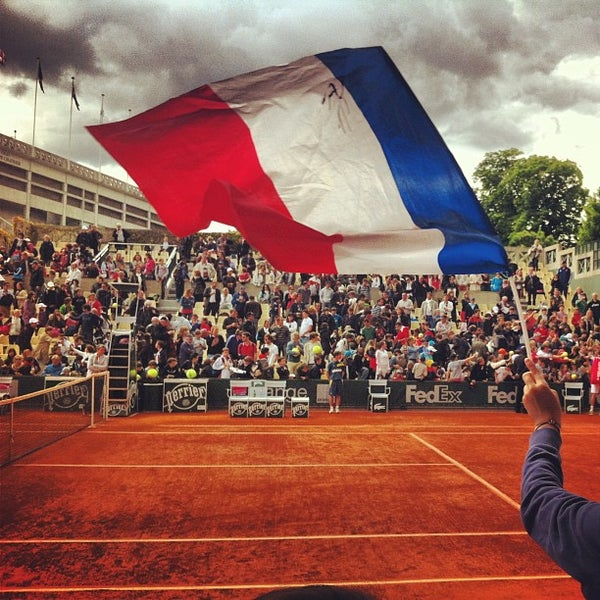 Photo taken at Stade Roland Garros by Sandra B. on 5/29/2013