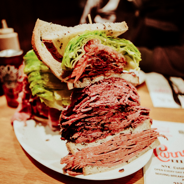 """When Carmelo Anthony came to town the deli immortalized him with a meat monument known as """"The Melo"""". It's a skyscraper of pastrami, salami, corned beef, lettuce, tomato, Russian dressing and bacon."""