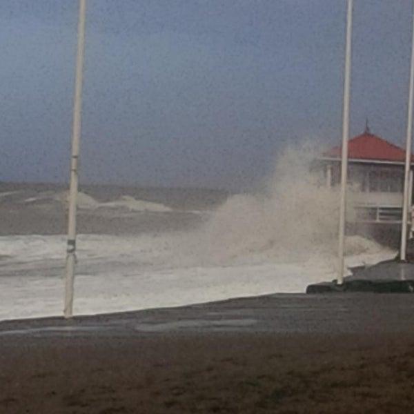 Photo taken at Aberystwyth Beach by Ben T. on 1/7/2014