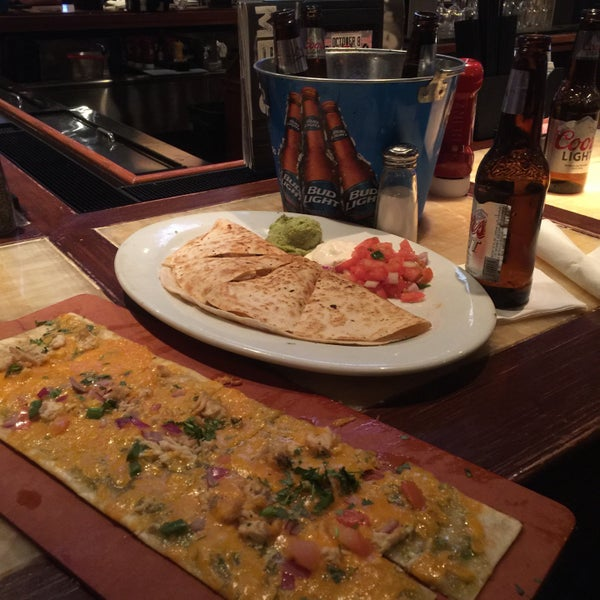 Photo taken at Bar Louie by Phouthasone B. on 9/23/2015