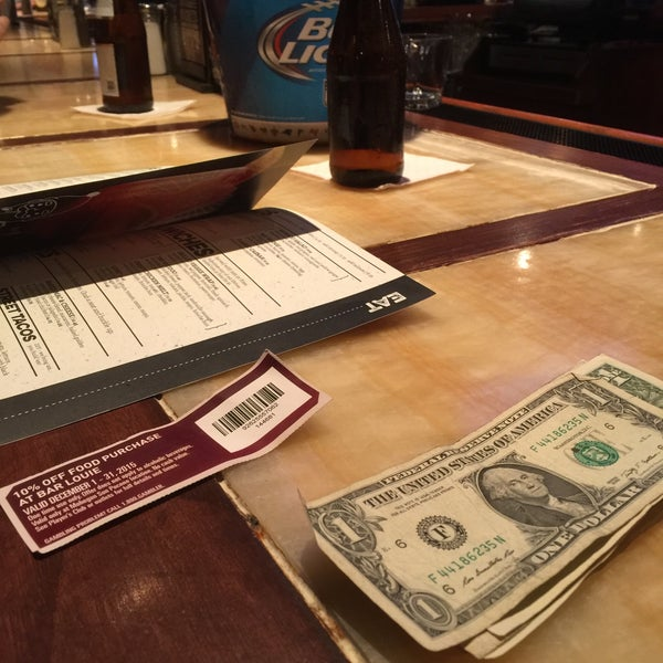 Photo taken at Bar Louie by Phouthasone B. on 12/10/2015