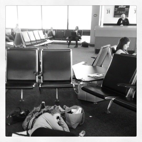 Photo taken at Gate C29 by Mackenzie R. on 5/6/2012