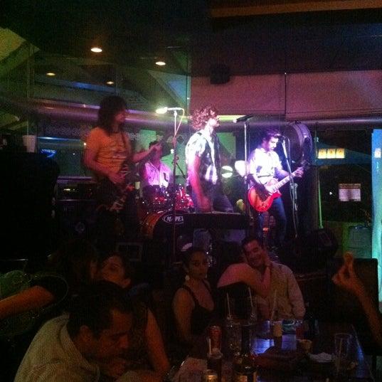 Photo taken at Dublin's Irish Pub by Stephanie G. on 3/17/2012