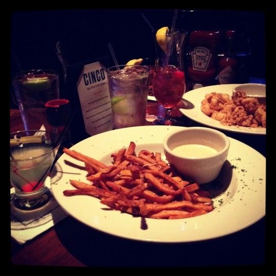 Photo taken at The Lion & Rose British Restaurant & Pub by Nina M. on 4/14/2012