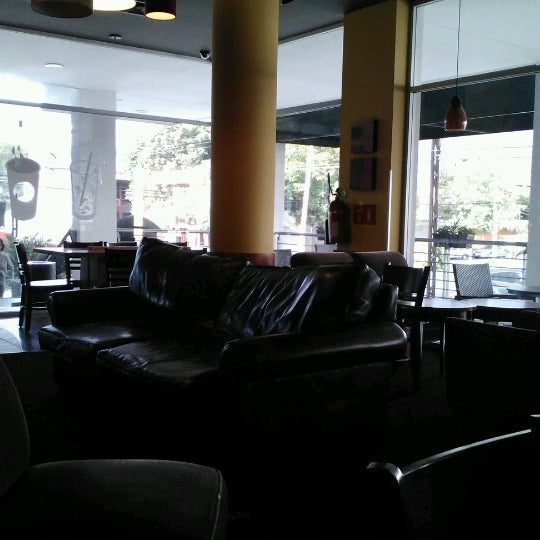 Photo taken at Starbucks by Javier A. on 7/21/2012