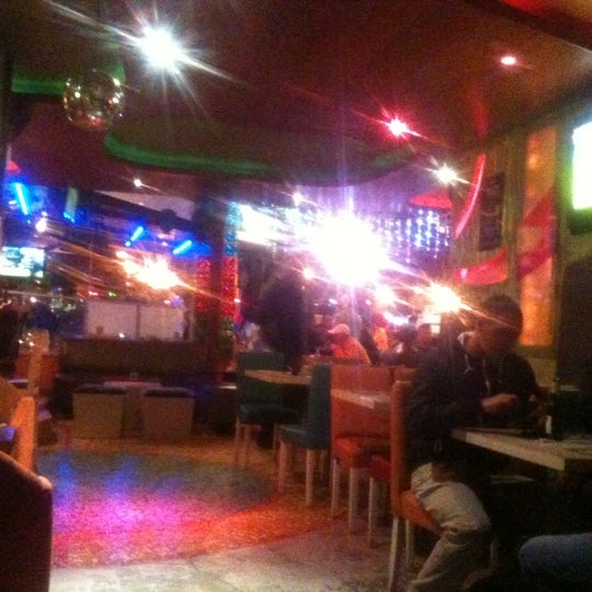 Photo taken at Azuca Latin Bistro by Jimmy M. on 3/1/2012