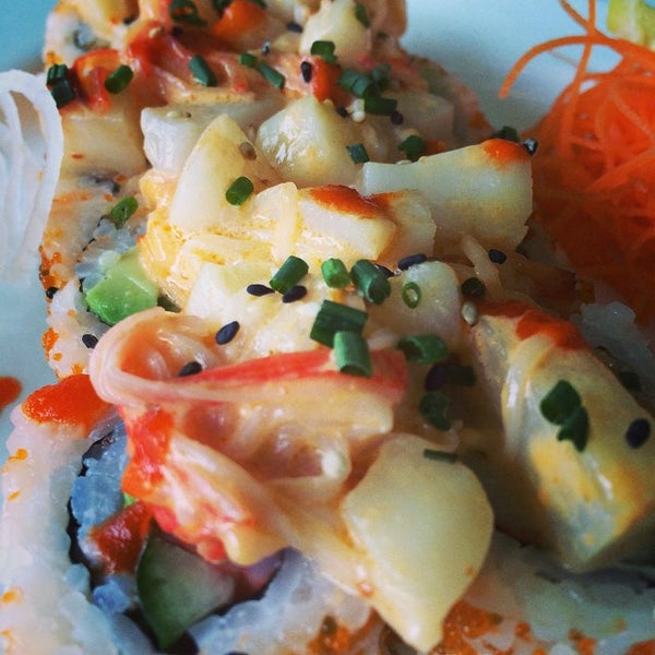 Photo taken at Yumm Thai : Sushi and Beyond by Paul V. on 10/11/2014