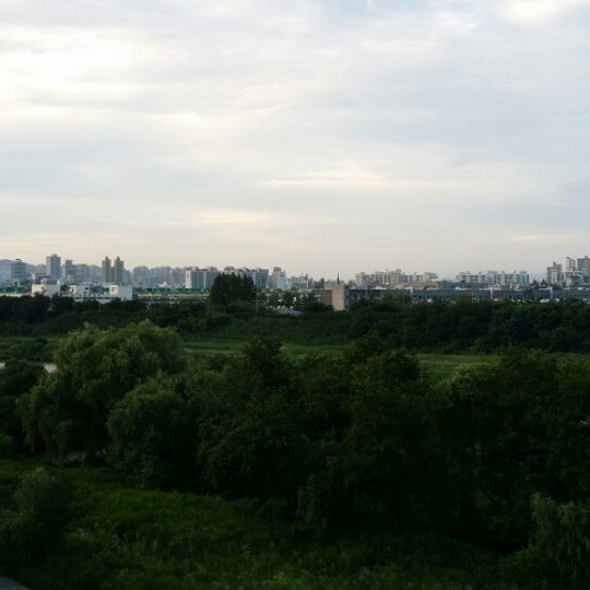 Photo taken at 광평교 by Jason S. on 7/10/2014