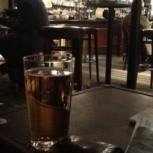 Photo taken at The Tin Goose (Pub & Kitchen) by Rob C. on 1/5/2014